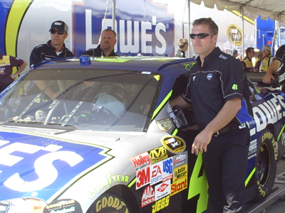 Rear Tire Carrier and Car Chief Ron Malec steers the No. 48 Lowe's Chevrolet through inspection
