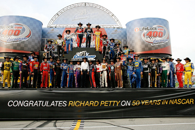The 43 drivers starting the LifeLock.com 400 pose with Richard Petty, who was celebrating his 50th anniversary in NASCAR. (Photo Credit: Geoff Burke/Getty Images for NASCAR)