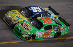 Race winner Kyle Busch (18) and runner-up Carl Edwards (99) race side-by-side on the last lap of the Coke Zero 400 Powered by Coca-Cola at Daytona International Speedway. (Photo Credit: John Harrelson/Getty Images for NASCAR)