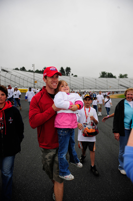 Carl Edwards picks up a fan during Saturday's NASCAR Foundation Track Walk following the NASCAR Nationwide Series at New Hampshire Motor Speedway (Photo Credit: Rusty Jarrett/Getty Images for NASCAR)