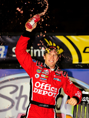 Carl Edwards celebrates winning the Sharpie 500 at Bristol Motor Speedway. The win was Edwards' third in the last four races and secured his spot in the Chase for the NASCAR Sprint Cup. (Photo Credit: Rusty Jarrett/Getty Images for NASCAR)