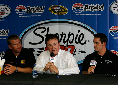 Richard Childress (center) announces that Casey Mears (right) will join RCR in 2009 and drive the No. 07 Jack Daniel's Chevrolet. Clint Bowyer (left) will move to a new fourth RCR team, the No. 33 Cheerios Chevrolet. (Photo Credit: Kevin C. Cox/Getty Images)