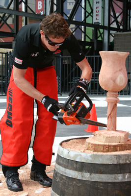 IndyCar driver Scott Dixon carves wood with a chainsaw at Infineon Raceway (photo credit: Gary Phillips)