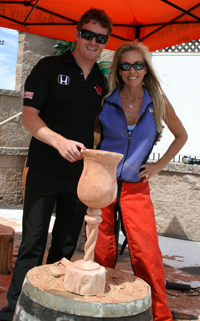 IndyCar driver Scott Dixon poses with Chainsaw Chick Cherie Currie at Infineon Raceway