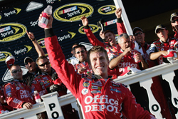 Carl Edwards, driver of the No. 99 Office Depot Ford, in Victory Lane as the winner of the NASCAR Sprint Cup Series Sunoco Red Cross Pennsylvania 500 on Sunday at Pocono Raceway. (Photo Credit: Jason Smith/Getty Images for NASCAR)