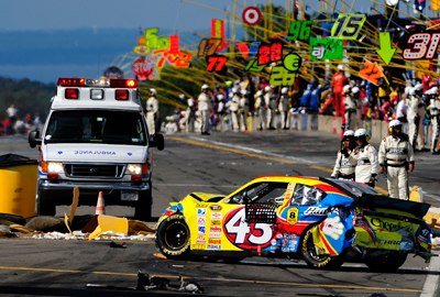 The #43 Cheerios Dodge driven by Bobby LaBonte sits on Pit road after a multi car incident during the NASCAR Sprint Cup Series Centurion Boats at the Glen at the Watkins Glen International on August 10, 2008 in Watkins Glen, NY. (Photo by Rusty Jarrett/Getty Images for NASCAR)