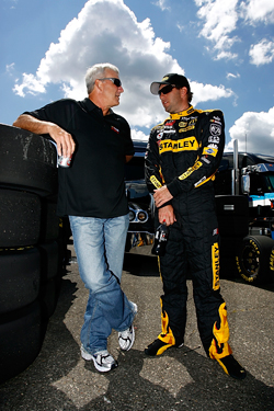 Former driver and now TV commentator Dale Jarrett chats with driver of the No. 19 Stanley Dodge Elliott Sadler during a Sprint Cup Series practice at Michigan International Speedway earlier this year. (Photo Credit: Jason Smith/Getty Images for NASCAR)