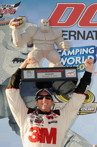 Hoisting the Monster Mile trophy above his head, Greg Biffle celebrates his NASCAR Sprint Cup Series Camping World RV 400 win Sunday at Dover International Speeday. (Photo Credit: Grant Halverson/Getty Images for NASCAR)