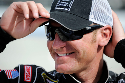 Even though he's pulling double duty this weekend by competiting in both the NASCAR Sprint Cup Series Camping World RV 400 and the NASCAR Nationwide Series Camping World RV Sales 200, driver Clint Bowyer is all smiles in the garage during Friday's practice at Dover International Speedway. (Photo Credit: Jeff Zelevansky/Getty Images for NASCAR)