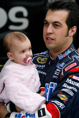 Sam Hornish Jr., driver of the #77 Mobil 1 Dodge, with his daughter Addison before practice for the NASCAR Sprint Cup Series Pep Boys Auto 500 at Atlanta Motor Speedway on October 24, 2008 in Hampton, Georgia. (Photo by John Harrelson/Getty Images for NASCAR)