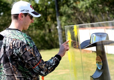 NASCAR Sprint Cup Series star Kyle Busch signs his name with the paint splatter on the prize -- the Dickies 500 trophy -- after he and his team defeated the local Dallas/Fort Worth media in paintball warfare for a Texas Motor Speedway media event Tuesday, Sept. 30, at Fun On The Run Paintball Park in Fort Worth, Texas. (Photo By Tom Pennington/Getty Images for the Texas Motor Speedway)