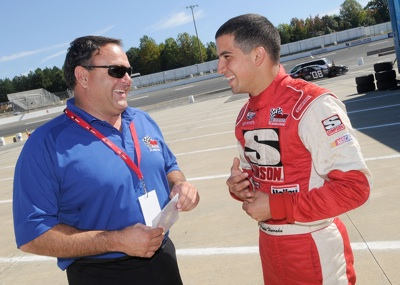 Current Drive for Diversity participant Paul Harraka, who won the track championship at All American Speedway in Roseville, Calif., chats with team owner Bill McAnally during the Drive for Diversity Combine presented by Sunoco at South Boston Speedway. (Photo Credit: Grant Halverson/Getty Images for NASCAR)