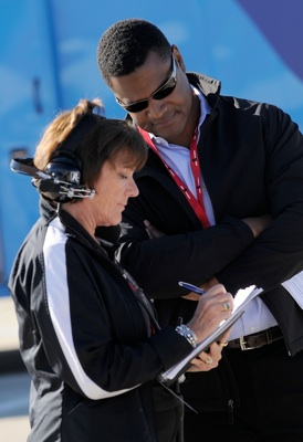 NASCAR Managing Director of Public Affairs Marcus Jadotte, who oversees the diversity department, huddles with Lyn St. James, who was offering guidance to the drivers at the Drive for Diversity Combine presented by Sunoco at South Boston Speedway. (Photo Credit: Grant Halverson/Getty Images for NASCAR)