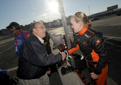 Trista Stevenson of Pocahontas, Ill. is congratulated by Brett Bodine after her time on track during the Drive for Diversity Combine presented by Sunoco at South Boston Speedway. (Photo Credit: Grant Halverson/Getty Images for NASCAR)