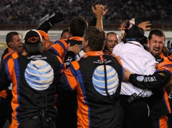 Jeff Burton's pit crew celebrates winning the Bank of America 500 at Lowe's Motor Speedway. (Photo Credit: Sam Greenwood/Getty Images)