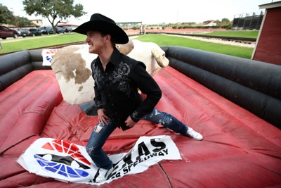 NASCAR Sprint Cup Series driver Scott Speed limbers up before he tangles with the mechanical bull again in the Fort Worth Stockyards Tuesday, October 21, 2008.    (Photo By Tom Pennington/Getty Images for the Texas Motor Speedway)