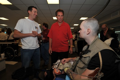 (Left to right) NASCAR Sprint Cup Series driver Kyle Busch and former NASCAR champion Darrell Waltrip visit a soldier at Walter Reed Army Medical Center's Military Advance Training Center in Washington, D.C. NASCAR made its annual visit to the facility to salute the troops on Thursday. (Photo Credit: Larry French/Getty Images for NASCAR)