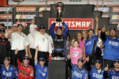 Johnny Benson, driver of the #23 Exide Toyota, celebrates in victory lane after winning the 2008 NASCAR Craftsman Truck Series after racing during the NASCAR Craftsman Truck Series Ford 200 at Homestead-Miami Speedway on November 14, 2008 in Homestead, Florida.  (Photo by Sam Greenwood/Getty Images for NASCAR)