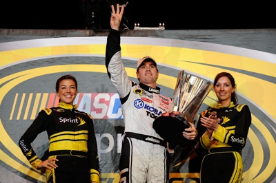 Jimmie Johnson (C), driver of the #48 Lowe's/Kobalt Tools Chevrolet, celebrates after winning the 2008 NASCAR Sprint Cup Series Championship after the Ford 400 at Homestead-Miami Speedway on November 16, 2008 in Homestead, Florida.  (Photo by Rusty Jarrett/Getty Images for NASCAR)