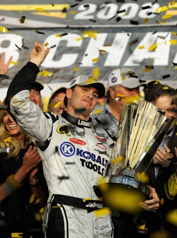 Jimmie Johnson, driver of the #48 Lowe's/Kobalt Tools Chevrolet, celebrates after winning the 2008 NASCAR Sprint Cup Series Championship after the Ford 400 at Homestead-Miami Speedway on November 16, 2008 in Homestead, Florida.  (Photo by Rusty Jarrett/Getty Images for NASCAR)