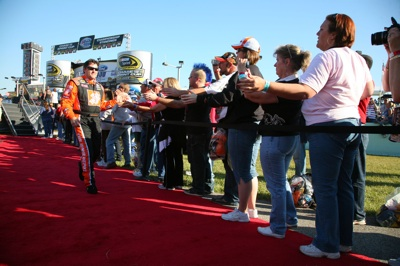 Tony Stewart greets fans during the NASCAR Sprint Cup Series Ford 400 at Homestead-Miami Speedway on November 16, 2008 in Homestead, Florida. (Getty Images for NASCAR)