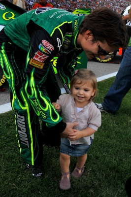 Jeff Gordon, driver of the No. 24 DuPont Chevrolet, started from the pole position and finished second in Sunday's NASCAR Sprint Cup event at Texas Motor Speedway. Here he is prerace with daughter Ella Sofia. (Courtesy Hendrick Motorsports)