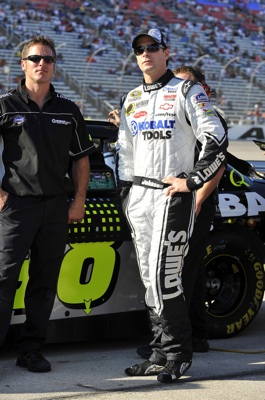 Jimmie Johnson (right), driver of the No. 48 Lowes Chevrolet stands with his car chief Ron Malec (left), started seventh and finished 15th in Sunday's NASCAR Sprint Cup event at Texas Motor Speedway. (Courtesy Hendrick Motorsports).