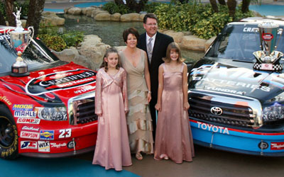 NASCAR Craftsman Truck Series champion Johnny Benson stands with (left to right) daughter Mikayla, wife Debbie and daughter Katelyn in the Seminole Paradise Courtyard at Seminole Hard Rock Hotel & Casino in Hollywood, Fla. (Photo Credit: Marc Serota/Getty Images for NASCAR)
