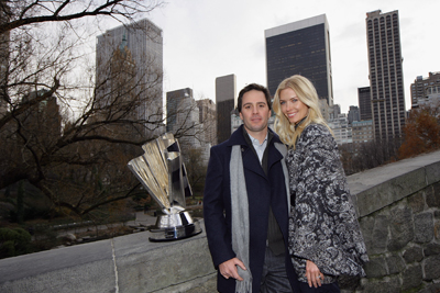 Jimmie and Chandra Johnson pose with the NASCAR Sprint Cup Series trophy on a bridge over The Pond in Central Park. (Photo Credit: Chris Trotman/Getty Images for NASCAR)