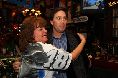 A Jimmie Johnson fan meets her man Wednesday at Foley's in New York City during Champions Week. (Photo Credit: Mike Stobe/Getty Images for NASCAR)