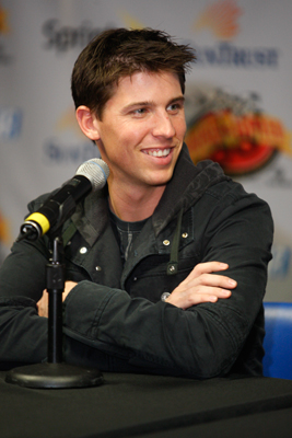NASCAR Sprint Cup Series driver Denny Hamlin shares a laugh during a news conference at the Sprint Sound and Speed Fan Festival Presented by SunTrust Saturday at the Nashville Municipal Auditorium. (Photo Credit: Steve Green/Getty Images for NASCAR)