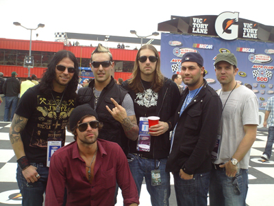 The band Rev Theory at Auto Club Speedway in Fontana, CA on Sunday, February 22, 2009. (Photo credit: The Fast and the Fabulous)