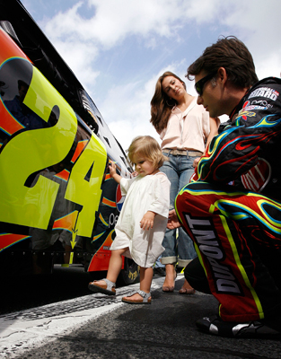 Some might say Jeff Gordon, driver of the No. 24 DuPont Chevrolet, may have had a couple of good luck charms Thursday at NASCAR Sprint Cup Series Gatorade Duel 1. Wife Ingrid Vandebosch and daughter Ella Sophia hang out with the four-time NASCAR champion the grid prior to the race at Daytona International Speedway that he won. (Photo Credit: Jason Smith/Getty Images for NASCAR)
