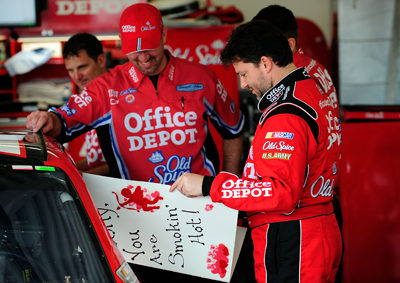 NASCAR Sprint Cup Series driver Tony Stewart reads a Valentine's Day card before getting into his car for the final NASCAR Sprint Cup Series practice for the Daytona 500 on Saturday at Daytona International Speedway. (Photo Credit: Sam Greenwood/Getty Images for NASCAR)