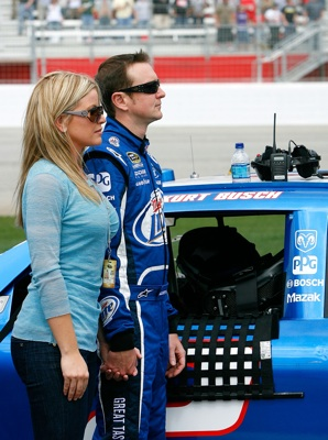 Kurt Busch, driver of the No. 2 Miller Lite Dodge, and his wife Eva participate in pre-race activities on pit road before the start of Sunday's NASCAR Sprint Cup Series Kobalt Tools 500 at the Atlanta Motor Speedway. (Photo Credit: Kevin C. Cox/Getty Images)
