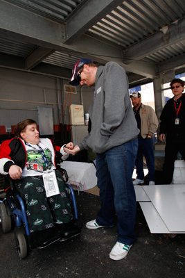 Race fan Wessa Miller presents a penny to Dale Earnhardt Jr. prior to the Food City 500 at Bristol Motor Speedway. Miller gave Dale Earnhardt a lucky penny before he won the 1998 Daytona 500. (Photo Credit: Chris Graythen/Getty Images for NASCAR)