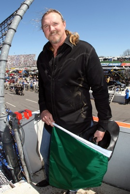 Country music star Trace Adkins smiles in the flagstand before waving the green flag to start the Goody's Fast Pain Relief 500 at Martinsville Speedway. (Photo Credit: Nick Laham/Getty Images)