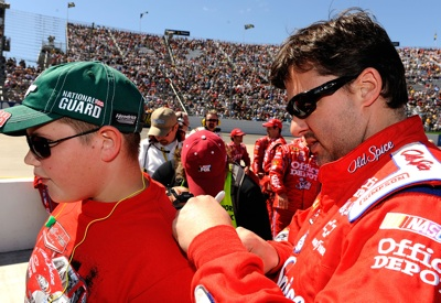 Tony Stewart signs an autograph for a fan prior to climbing into his car for the Goody's Fast Pain Relief 500 at Martinsville Speedway. (Photo Credit: Rusty Jarrett/Getty Images for NASCAR)