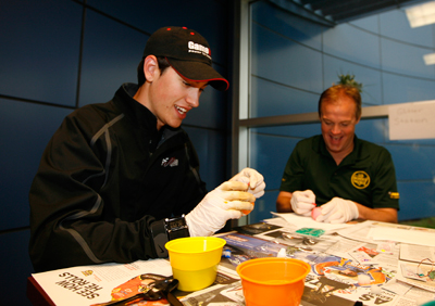 Joey Logano and Kenny Wallace dye Easter eggs as part of a driver and media contest on Friday. (Photo Credit: John Sommers II/Getty Images for NASCAR)