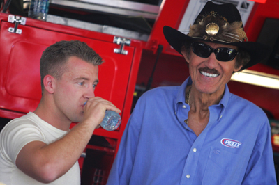 AJ Allmendinger shares a moment with team owner Richard Petty after the team announced Allmendinger has signed a contract to remain at Richard Petty Motorsports through the end of 2010. (Photo Credit: Todd Warshaw/Getty Images)