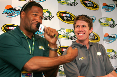 Subway Fresh Fit 500 Grand Marshall Michael Strahan and Carl Edwards share a laugh in the media center before the race. (Photo Credit: Todd Warshaw/Getty Images)