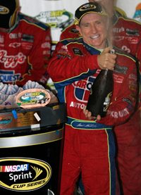 Mark Martin celebrates in Victory Lane for the first time in 97 starts. His last win was at Kansas Speedway in October 2005. (Photo Credit: Jerry Markland/Getty Images for NASCAR)