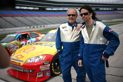 Foreigner chief songwriter /guitarist/keyboardist and founding member Mick Jones and lead singer Kelly Hansen reflect on the experience after taking a ride in a Team Texas stock car at Texas Motor Speedway Monday, March 30, 2009. The band is headlining the AMDRO Fire Ant Bait Pre-Race Show beginning at 11:35 a.m. CT, prior to the start of the Samsung 500 NASCAR Sprint Cup Series race on Sunday, April 5th at Texas Motor Speedway. (Photo By Tom Pennington/Getty Images for the Texas Motor Speedway)