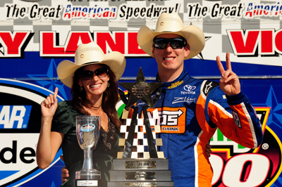 Kyle Busch (R), driver of the #18 Snickers Toyota, poses with his girlfriend Samantha Sarcinella in victory lane after winning the NASCAR Nationwide Series O'Reilly 300 at Texas Motor Speedway on April 4, 2009 in Fort Worth, Texas. (Photo by Rusty Jarrett/Getty Images for Texas Motor Speedway)