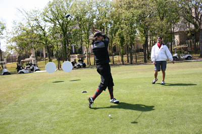 Kyle Petty tees off during the AutoTrader.com Gears & Greens Charity Golf Classic on April 2, 2009 in Fort Worth, Texas. (Photo by Tom Pennington/Getty Images for Texas Motor Speedway)