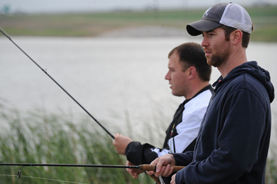NASCAR driver Ryan Newman (left) fishes with country music artist Josh Turner during Aaron's Fish & Fun at the Races at Texas Motor Speedway on April 4, 2009 in Fort Worth, Texas. (Photo by Ronald Martinez/Getty Images for Texas Motor Speedway)