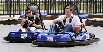 NASCAR driver Denny Hamlin and Dallas Cowboys tight end Jason Witten make contact while racing around the track at SpeedZone in Dallas, Texas on Wednesday, April 1, 2009. The pair were racing to raise awareness for the March of Dimes and the 2009 March for Babies. (Photo By Tom Pennington/Getty Images for the Texas Motor Speedway)