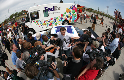 Dallas Cowboys tight end Jason Witten (center) talks with the media after racing NASCAR driver Denny Hamlin around the track at SpeedZone in Dallas, Texas Wednesday, April 1, 2009. The pair were racing to raise awareness for the March of Dimes and the 2009 March for Babies. (Photo By Tom Pennington/Getty Images for the Texas Motor Speedway)