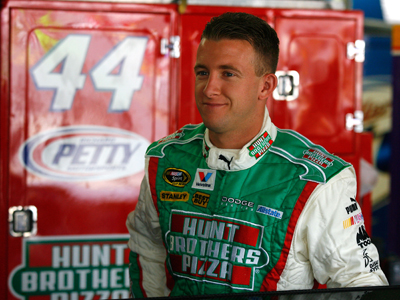 AJ Allmendinger is all smiles after posting the quickest time during NASCAR Sprint Showdown practice at Lowe's Motor Speedway. (Photo Credit: Jason Smith/Getty Images)