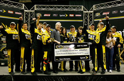 The No. 31 Richard Childress Racing Caterpillar team, including Jeff Burton's wife, Kim (right), who drove the car, celebrates winning the NASCAR Sprint Pit Crew Challenge Presented by Craftsman Thursday in Charlotte, N.C. at the Time Warner Cable Arena. (Photo Credit: Geoff Burke/Getty Images for NASCAR)